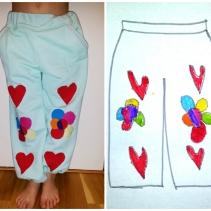 Syprojekt 220 Mjukisbyxor efter Hannes' design. Han ritade en bild och jag klippte i resttyger. Fickorna är kantade med små hjärtan från symaskinens inbyggda sömmar.